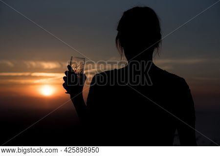 Woman Drink A Beer In The Island Of Formentera In The Balearic Islands In Spain At Sunset.