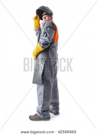 Portrait of welder wearing protective welding black leather apron and welding hood standing over white