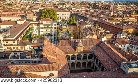 Tiled roofs of Bologna city, Italy. Panoramic view from above, italian cityscape