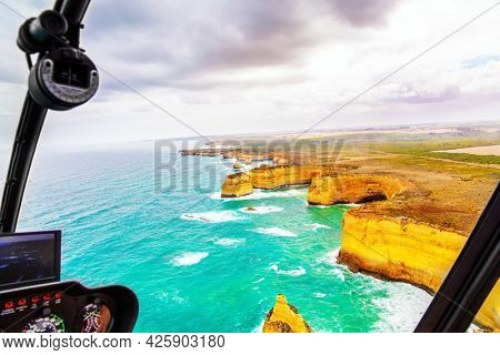Helicopter flight over the scenic Pacific coastline. The fabulous journey to Australia. Legendary cliffs