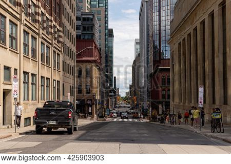 Street View With Walking People In Downtown Of Ottawa.