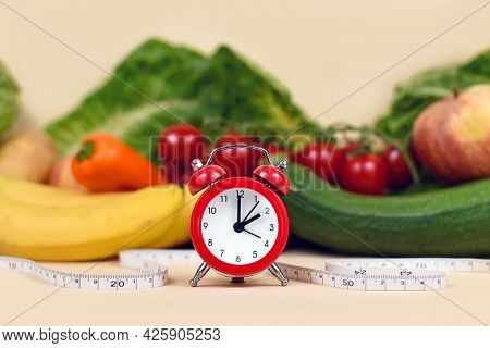 Concept For Loosing Weight With Only Eating Healthy Food At Certain Times With Vegetables, Fruits, M