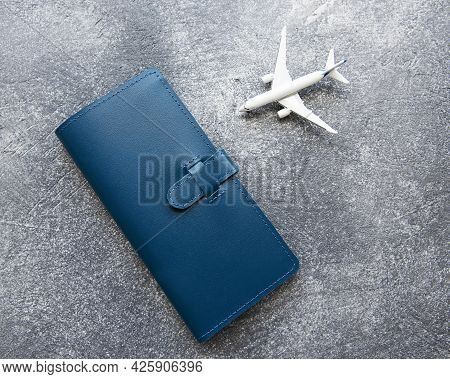 Blue Leather Travel Purse Where You Can Hold Passport, Money, Boarding Pass, Top View, Flat Lay, Tra