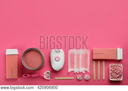 Set Of Epilation Products On Pink Background, Flat Lay. Space For Text
