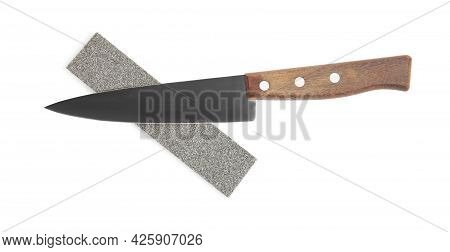 Sharpening Stone And Knife On White Background, Top View