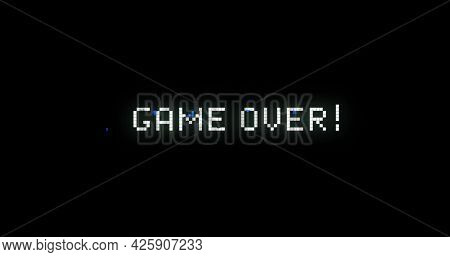 Image of image game screen with flickering Game Over! text written in digital font on black background. Colour light movement concept digitally generated image.