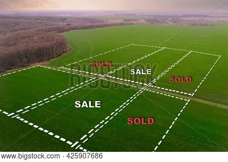 Marking Of Farm Field Plots With Inscriptions Sold And Sold. Buying And Selling Concept On The Land