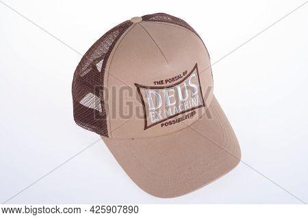 Toulouse , Ocitanie France  - 06 30 2021 : Deus Ex Machina Customs Brown Cap With Logo Brand Fashion