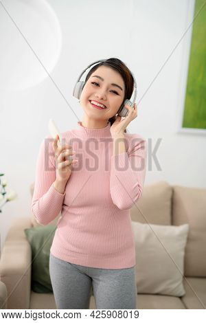 Young Woman Enjoying The Music By Smart Phone And Relax At Home, Asian Beauty