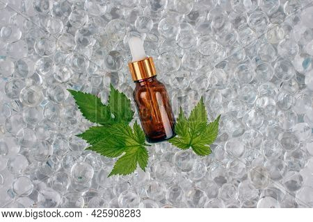 Mockup Image Of Dropper Bottle With Natural Organic Herbal Cosmetic Oil On Light Background Made Wit