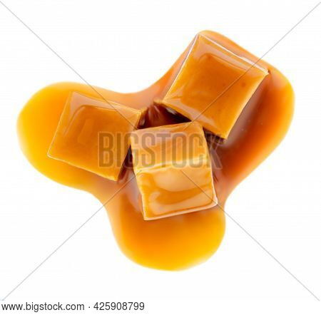 Caramel Candies With Caramel Sweet Sauce Isolated On A White Background Close Up.