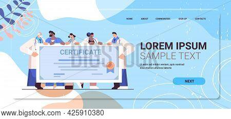 Graduated Doctors Holding Certificate Happy Graduates Celebrating Academic Diploma Degree University