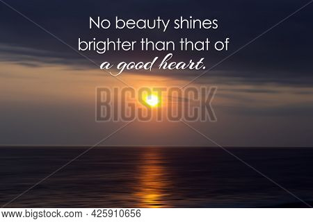 Inspirational Quote - No Beauty Shines Brighter Than That Of A Good Heart. On Background Of Sunset N