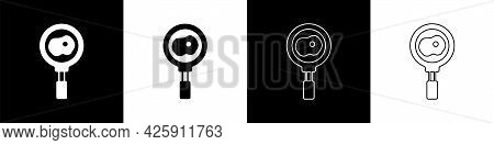 Set Fried Eggs On Frying Pan Icon Isolated On Black And White Background. Fry Or Roast Food Symbol.