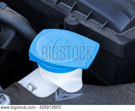 Blue Cover Of The Windshield Washer Reservoir In The Car, Close-up. Windscreen
