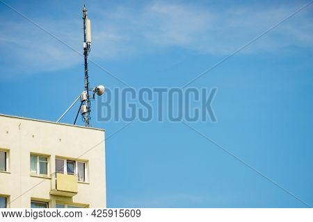 Signal Or Mobile Phone Tower Against Blue Sky. Radio Antenna. Modern Telecommunication By Using 5g O