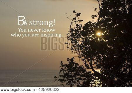 Inspirational Motivational Quote - Be Strong. You Never Know Who You Are Inspiring. With Sunset Over
