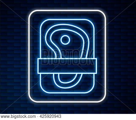 Glowing Neon Line Meat Packaging Steak Icon Isolated On Brick Wall Background. Fresh Meat Beef Steak