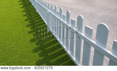 Wide Angle And Diagonal View Of White Wooden Picket With Green Artificial Turf In Front Yard Area
