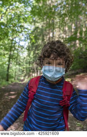 Weekend Getaway To Hochsauerlandkreis Forest Walk Paths. Child Afraid Of Corona Covid 19 Pandemic An