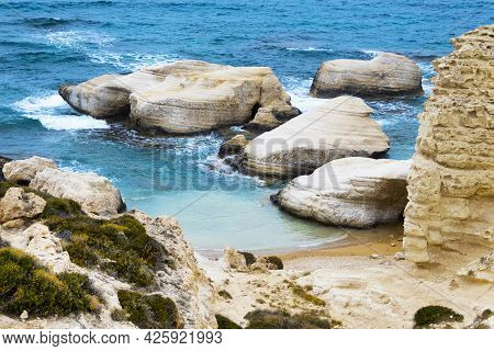 Ocean Waves Splash Against Beach With Rocks Background, Cliffs In The Sea, Top Aerial View Of Cyprus