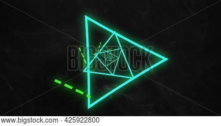 Image of multiple colourful green and blue neon triangles spinning and moving on black background. Colour light movement concept digitally generated image.