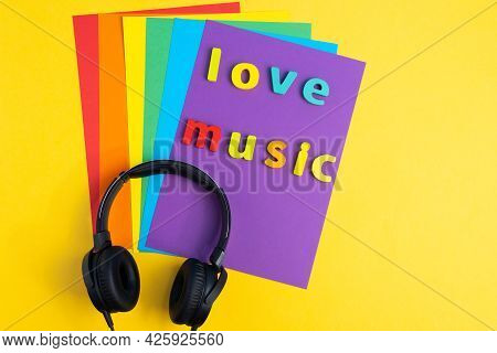 Love For Music Headphones On A Colored Background. Top View. Copy Space