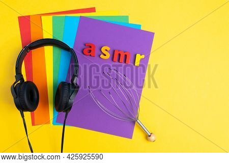 Audio Healing, Letters Asmr Headphones, Top View, Multi-colored Background. Copy Space