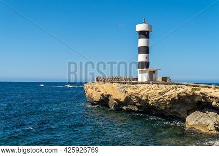 Lighthouse Of Colonia De Sant Jordi On The Island Of Mallorca With The Mediterranean Sea And The Isl