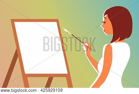Beautiful Young Woman Draws Behind An Easel