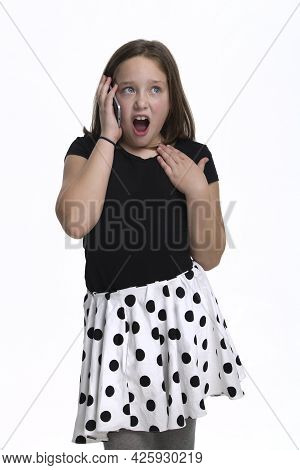 Young Tween Girl Having A Conversation On A Phone.