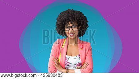 Composition of female fashion designer smiling on pink background. fashion design, fashion show and clothing concept digital image.