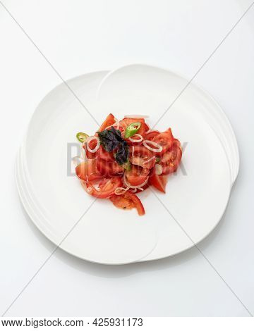 Platter With Fresh Tomato, Onion And Basil Salad Isolated On White Background. Healthy Vegetarian Fo