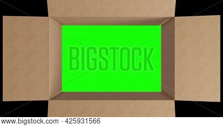 Overhead of green screen in brown cardboard box with lid closing on black background. packing box in preparation for shipment or transportation.