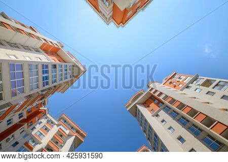 Brand new modern apartment buildings shot from below using wide angle fisheye lens