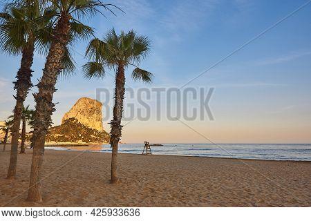 Penon De Ifach And Mediterranean Beach At Sunset. Alicante, Spain