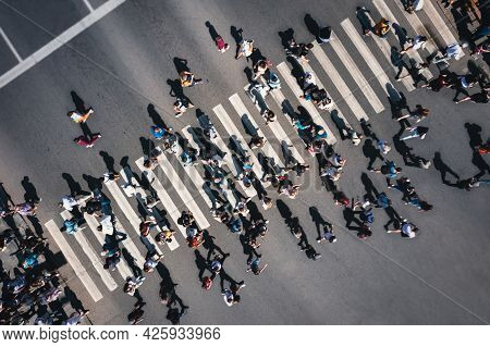 Different People At A Pedestrian Crossing In The City. People At A Zebra Pedestrian Crossing - A Lot