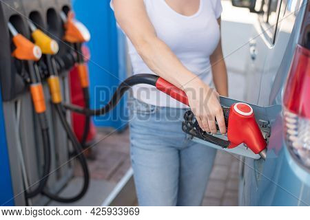 Caucasian Woman Refueling A Car At A Self-service Gas Station.