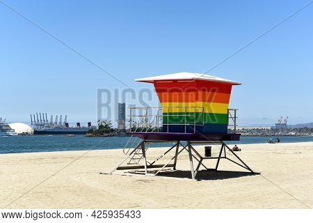 LONG BEACH, CALIF - 5 JUL 2021: Pride Tower, at Shoreline Way and 12th Pl. The rainbow-colored lifeguard tower supports the LGBTQ community replacing an earlier tower destroyed in an arson fire.