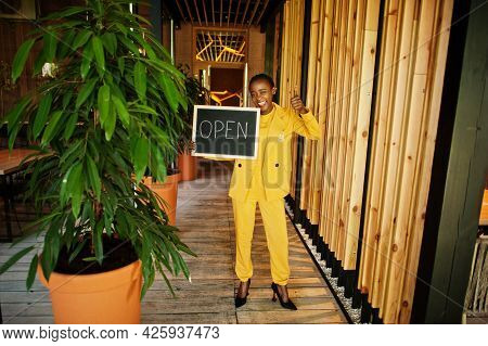African American Woman Hold Open Welcome Sign Board In Modern Cafe Coffee Shop Ready To Service, Res