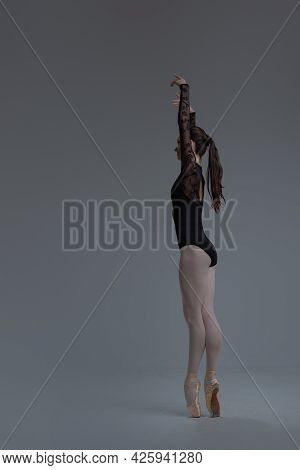 Ballet Dancer In Black Tutu Dancing Inside Studio