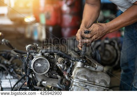 Close Up Hand Of Attractive Man Working Hard And Fix Auto Mechanic On Car Engine In Mechanics Garage
