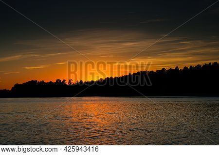Sunset Over The Forest Lake. Beautiful Sunset Over The Lake