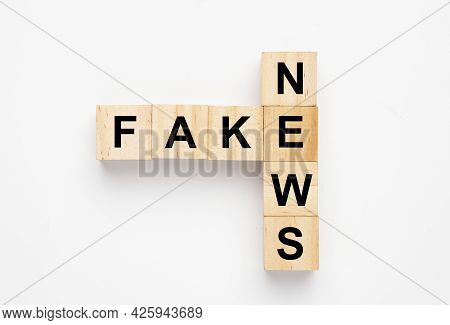 Wooden Block Arrange Fake News. Fake News Is Out Of Control.