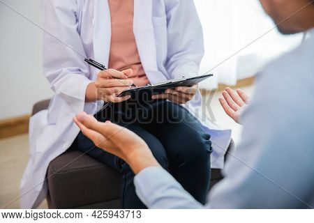Professional Psychologist Woman Conducting A Consultation And Talk With Asian Man Patient