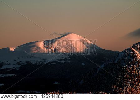 Magnificent View Of Mountain With Snow-capped Peaks Against The Sky At Sunrise