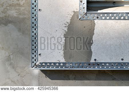 The Frame, With A Fixed Steel Profile-angle, Is Made Of Drywall Around The Window.the Plasterer Repa