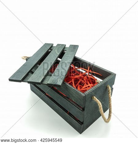 Black Wooden Box For Packing Gifts. Rope Handles, Red Straw Filling, Lattice Lid. Isolated On A Whit