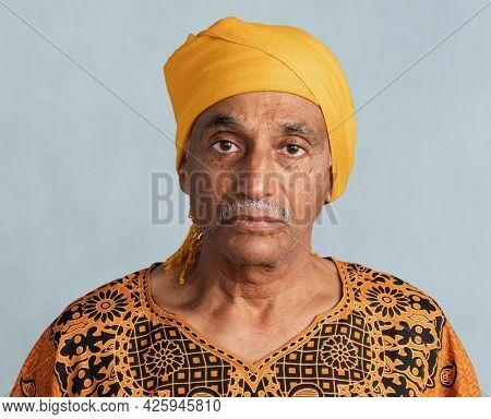 Mixed senior Indian man wearing a yellow turban mockup