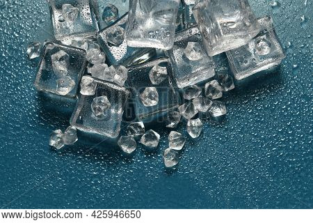 Ice Stone On Reflective Surface Of Background With Drops, Idea Of A Cold Environment Or A Very Cold